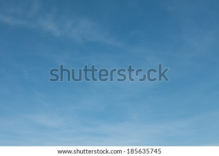 Fantastic soft white clouds against blue sky daylight. Natural composition of the sky. design element - stock photo
