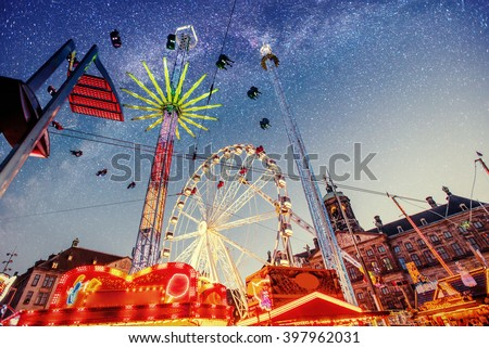 Fantastic starry sky on amusement park attractions. - stock photo