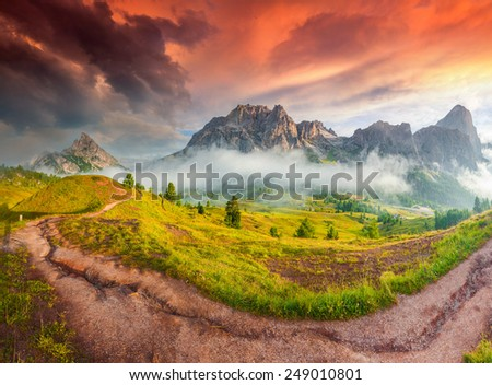 Fantastic summer sunrise on the Tofane mountain range. View from Falzarego pass. Dolomites mountains, Alps, Italy, Europe. - stock photo