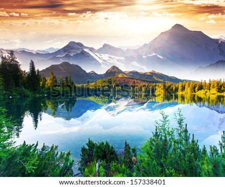 Fantastic sunny day is in mountain lake. Creative collage. Beauty world. - stock photo