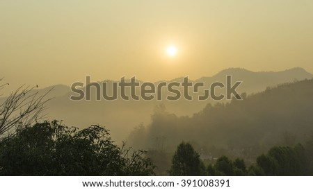 Fantastic sunrise  from the top of mountain with soft mist in pastel colours