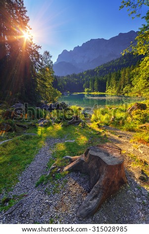 Fantastic sunrise on mountain lake Eibsee, located in the Bavaria, Germany. Dramatic unusual scene. Alps, Europe. - stock photo