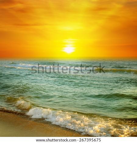 Fantastic sunrise on the ocean - stock photo