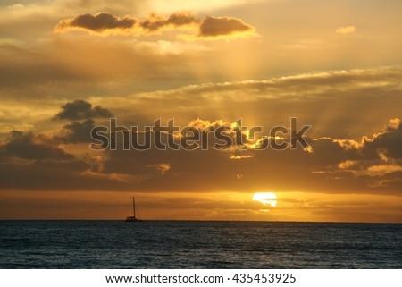 Fantastic sunset over the ocean at Kauai, Hawaii - stock photo