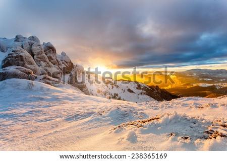 Fantastic sunset winter landscape. Dramatic overcast sky. - stock photo