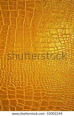 Fantastic unreal golden leather texture. Skin of golden dragon - stock photo