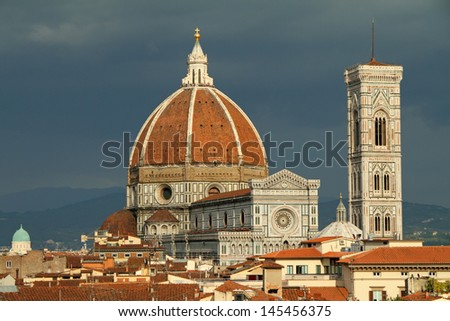 Fantastic view of  Basilica di Santa Maria del Fiore (  Basilica of Saint Mary of the Flower )  on navy blue sky .Design of Arnolfo di Cambio and  with  dome by Filippo Brunelleschi, Florence, Italy - stock photo