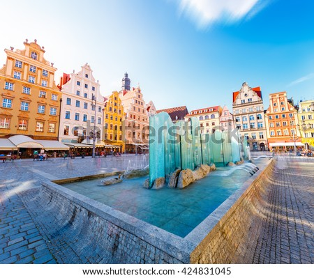 Fantastic view of the ancient homes on a sunny day. Gorgeous and picturesque scene. Location famous Market Square in Wroclaw, Poland, Europe. Historical capital of Silesia. Beauty world. Soft filter. - stock photo