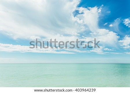 Fantastic view of the azure sea. Clear sky on a sunny day with fluffy clouds. Picturesque and gorgeous scene. Location place: Island Sicily, Italy, Europe. Artistic picture. Beauty world. - stock photo