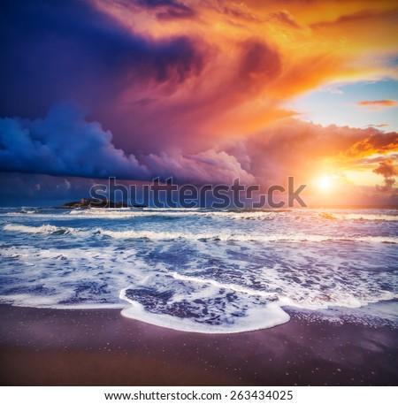 Fantastic view of the Isola delle Correnti. Located on cape Passero. Dramatic morning scene. Dark overcast sky. Sicilia, Italy, Europe. Mediterranean and Ionian sea. Beauty world. - stock photo