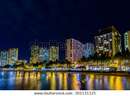 Fantastic view of tropical city at night in Honolulu, Hawaii, USA - stock photo