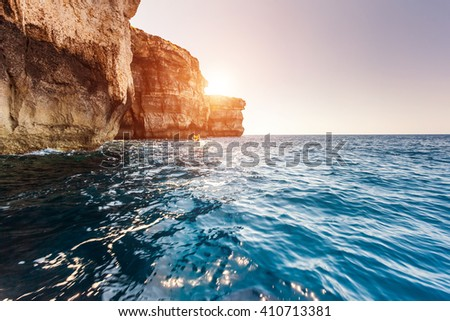 Fantastic views of rocky coast on a sunny day with blue sky. Picturesque and gorgeous scene. Location famous place Azure Window, Gozo island, Dwejra. Malta. Europe. Mediterranean sea. Beauty world. - stock photo