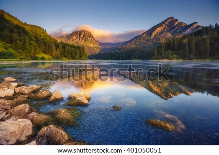 Fantastic views of the turquoise Lake Obersee under sunlight. Dramatic and picturesque scene. Location famous resort: Nafels, Mt. Brunnelistock, Swiss Alps. Europe. Artistic picture. Beauty world. - stock photo