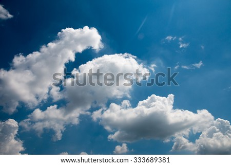 Fantastic white clouds against blue sky