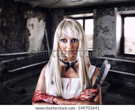 Fantastic woman in the style of doll  killer, zombie or a ghost with a bloody hatchet in hand - stock photo