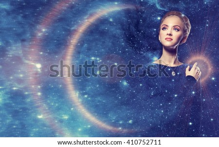 Fantastic woman with diamonds on a background of blue radiance space sky decorated with lots of stars. Fantastic, night, magic. Fairy woman in the rays of light planets and space.