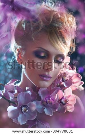 fantasy beautiful woman portrait with flower, composite photo - stock photo