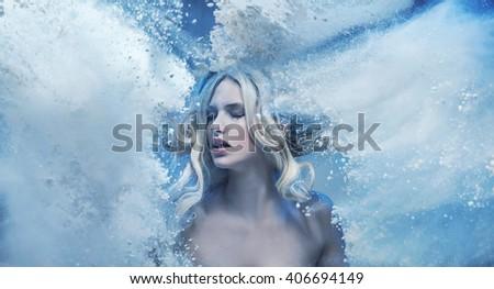 Fantasy expressive portrait of a blonde beauty - stock photo