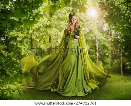 Fantasy Fairy Tale Forest, Fairytale Nature Goddess, Nymph Woman in Mysterious Green Dress - stock photo