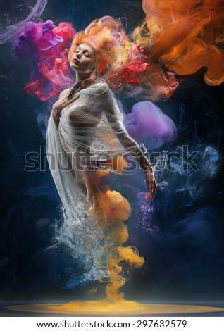 Fantasy fashion model inside colorful clouds. Water paint spreading underwater. Fantastic shapes in deep space. - stock photo