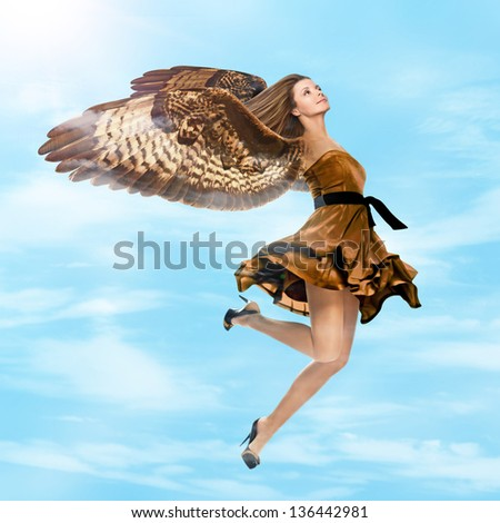 Fantasy girl with falcon wings flying in the sky - stock photo