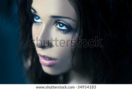 Fantasy glamour portrait of a young beauty with blue eyes - stock photo