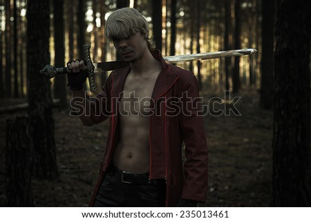 fantasy hero with a sword in the forest