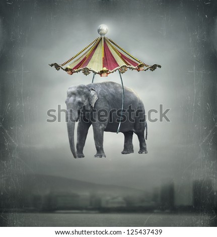 Fantasy image that represent a flying elephant with circus tent in the sky and landscape on the background - stock photo