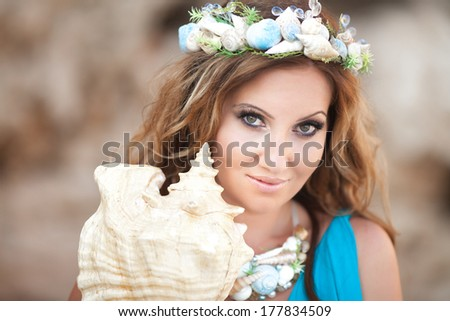 Fantasy makeup woman with shell wreath, mermaid girl with seashell. Fairy sea nymph.  Ocean Goddess. - stock photo