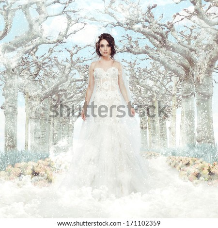 Fantasy. Matrimony. Bride in White Dress over Frozen Winter Trees and Snowflakes - stock photo