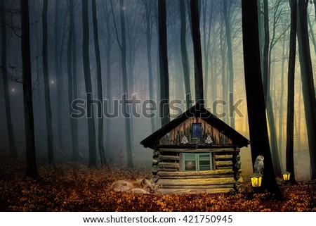 Fantasy picture with elfhouse,fox and dark forest - stock photo