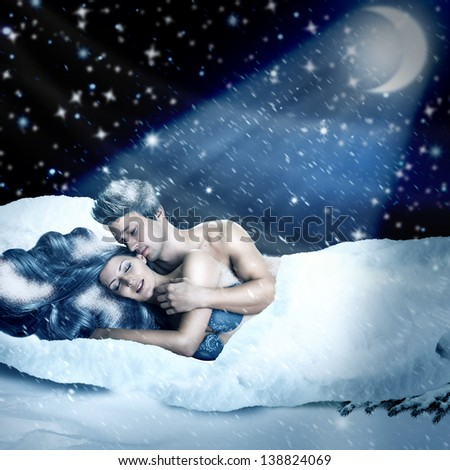 Fantasy romantic collage. Loving fairy couple  lying in bed of white snow outdoor in winter night. Tender Lovers have sex - stock photo