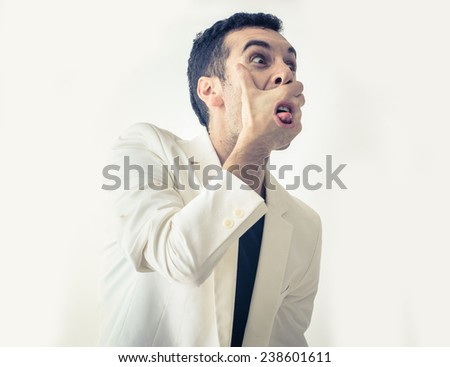 fantasy scream. man screaming through his hand - stock photo
