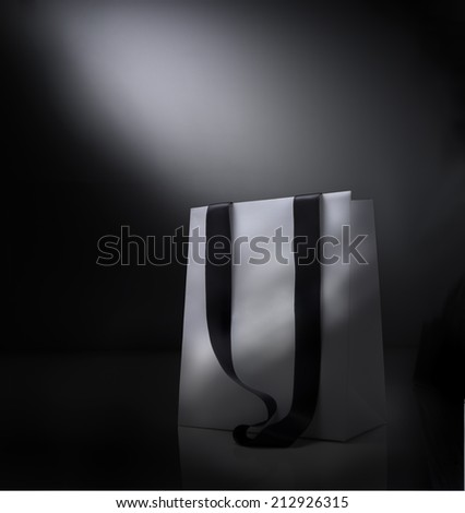 Fantasy shopping bag against  black background - stock photo