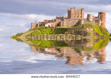 Fantasy view of Bamburgh Castle surrounded by water - stock photo