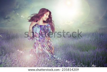 Fantasy. Woman in Enigmatic Meadow over Cloudy Sky - stock photo