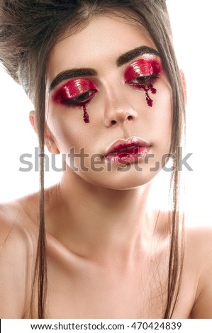 Fantasy woman portrait. Beautiful fashionable model with dark hair and brown eyes closeup. Creative make up.
