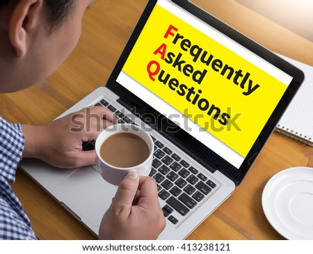 FAQ - Frequently Asked Questions Businessman at work. Close-up top view of man working on laptop while sitting at the wooden desk , coffee - stock photo