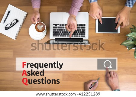 FAQ - Frequently Asked Questions man touch bar search and Two Businessman working at office desk and using a digital touch screen tablet and use computer, top view - stock photo