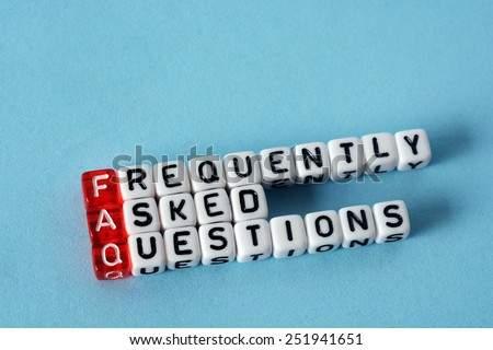 FAQ Frequently Asked Questions   written  on  cubes on blue  background - stock photo