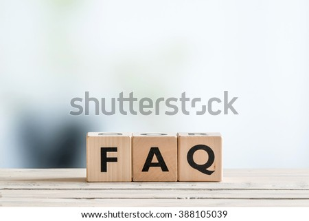 FAQ sign made of wood on an office table - stock photo