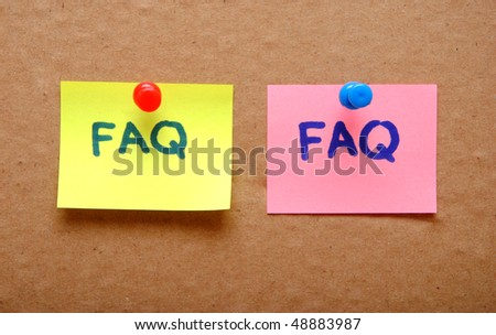 FAQ sticky notes over cardboard background - stock photo