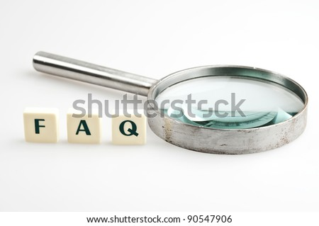 FAQ word and magnifying glass - stock photo