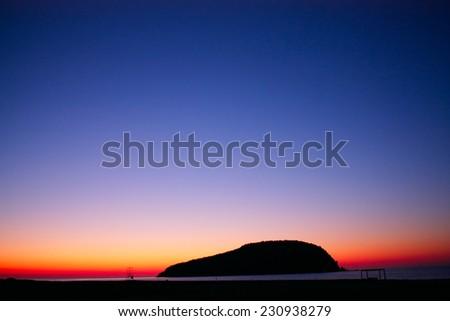 far island in the Japanese sea at sunrise - stock photo