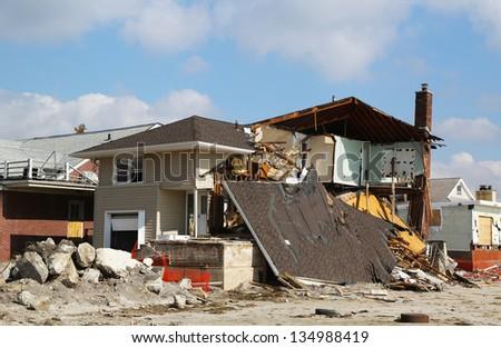 FAR ROCKAWAY, NY - FEBRUARY 28: Destroyed beach house three months after  Hurricane Sandy on February 28, 2013 in Far Rockaway, NY - stock photo