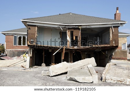 FAR ROCKAWAY, NY - NOVEMBER 11: Destroyed beach house in the aftermath of Hurricane Sandy on November 11, 2012 in Far Rockaway, NY