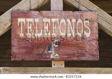 far west telephone sign in spanish - stock photo