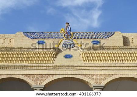 Faravahar on the top of the Zoroastrian temple  - stock photo