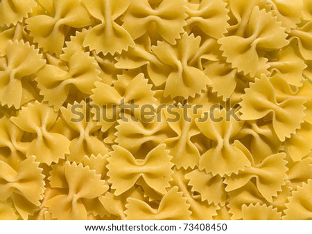 Farfalle - bow shaped pasta background - stock photo