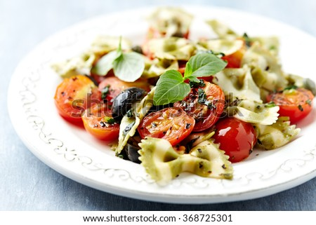 Farfalle with cherry tomatoes and capers  - stock photo